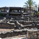 Ruins of Capernaum. In the background is a church built over the home of the Apostle Peter.